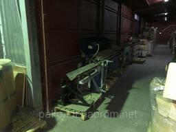 Автозавантажувач гільз, знімач готової продукції
