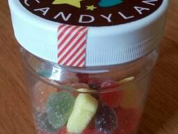 Пластиковая баночка для упаковки сладостей.