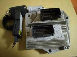 Блок управления двигателем Opel Astra H 12230740 FАНF б/у на