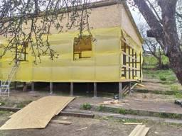 Дачный дом. Свайный фундамент. Металлокаркас