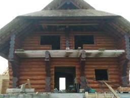 Дом-сруб из дикого бревна