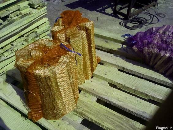 Дрова колотые в сетке
