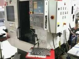 Фрезерний станок с ЧПУ HAAS DT1