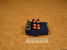 Гидрораспределитель типа Р80-3/1-222 применяется на тркторах