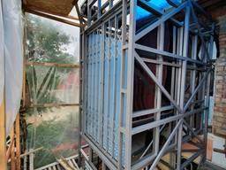 Грузовой подъёмник в клети Виралифт