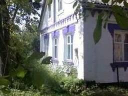 Кирпичный дом и 0,5 га земли