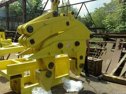 Клещевой захват для рулонов стали