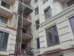 Подъемник строительный мачтовый