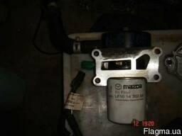 Кронштейн крепления масляного фильтра Mazda 6 (GG) 02-07