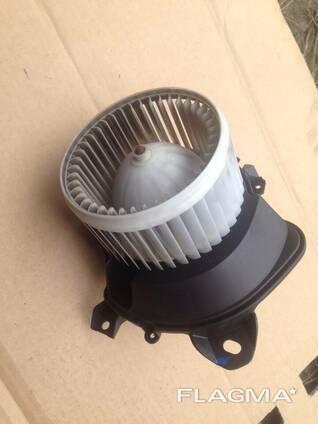 Моторчик вентилятор печки Opel Corsa D 13335075