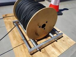 Оборудование ( устройство ) для размотки кабеля, провода.