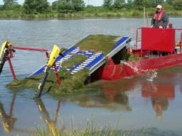 Очистка водоемов от водорослей и камыша водным комбайном DRW