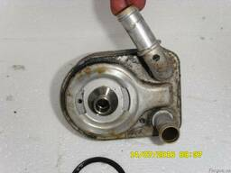 Охладитель масла 7SG-6B856-A4A FORD Fiesta MK7 08-11