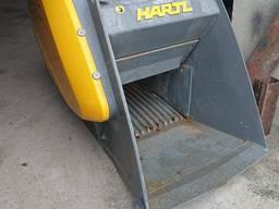 Переработка строительных отходов дробильним ковшом