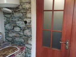 Продам двухкомнатную квартиру в частном секторе, центр г. Каменское, Днепропетровской обл