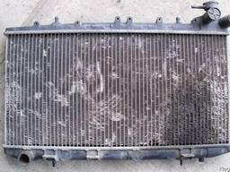 Радиатор охлаждения Nissan Sunny N14 (1990г-1995г)