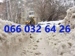 Расчистка / уборка снега экскаватором.
