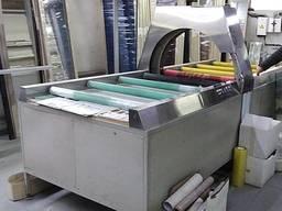 Станок для упаковки товаров и продукции стрейч-пленкой.