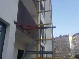 Фасадный мачтовый подъемник.