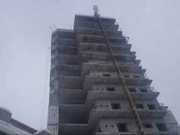 Подъёмник строительный мачтовый