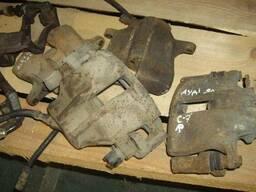 Суппорт тормозной Audi80 B4