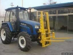 Трактор с функциями вилочного погрузчика