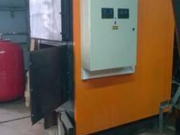 Твердотопливный котел с автоматизированной загрузкой топлива