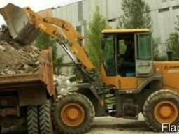 Очистка территории от бытового и строительного мусора. Вывоз