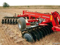 Услуги по обработке земли почвы полей аренда трактора плуга
