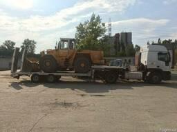 Услуги трала перевозки техники по Киеву и области