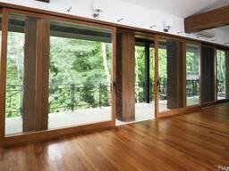 Подъемносдвижные деревянные оконные системы.