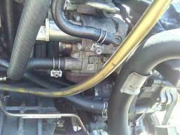 Вакуумный насос Nissan Pathfinder Navara 14650-EB300 EB30A