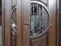 Виготовлення металевих вхідних дверей із накладками
