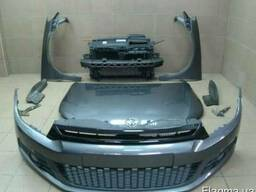 Запчасти б/у на Volkswagen Scirocco III Бампер Фара